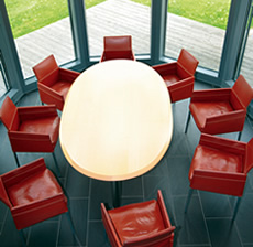 Modern meeting room with 8 chairs around a large table